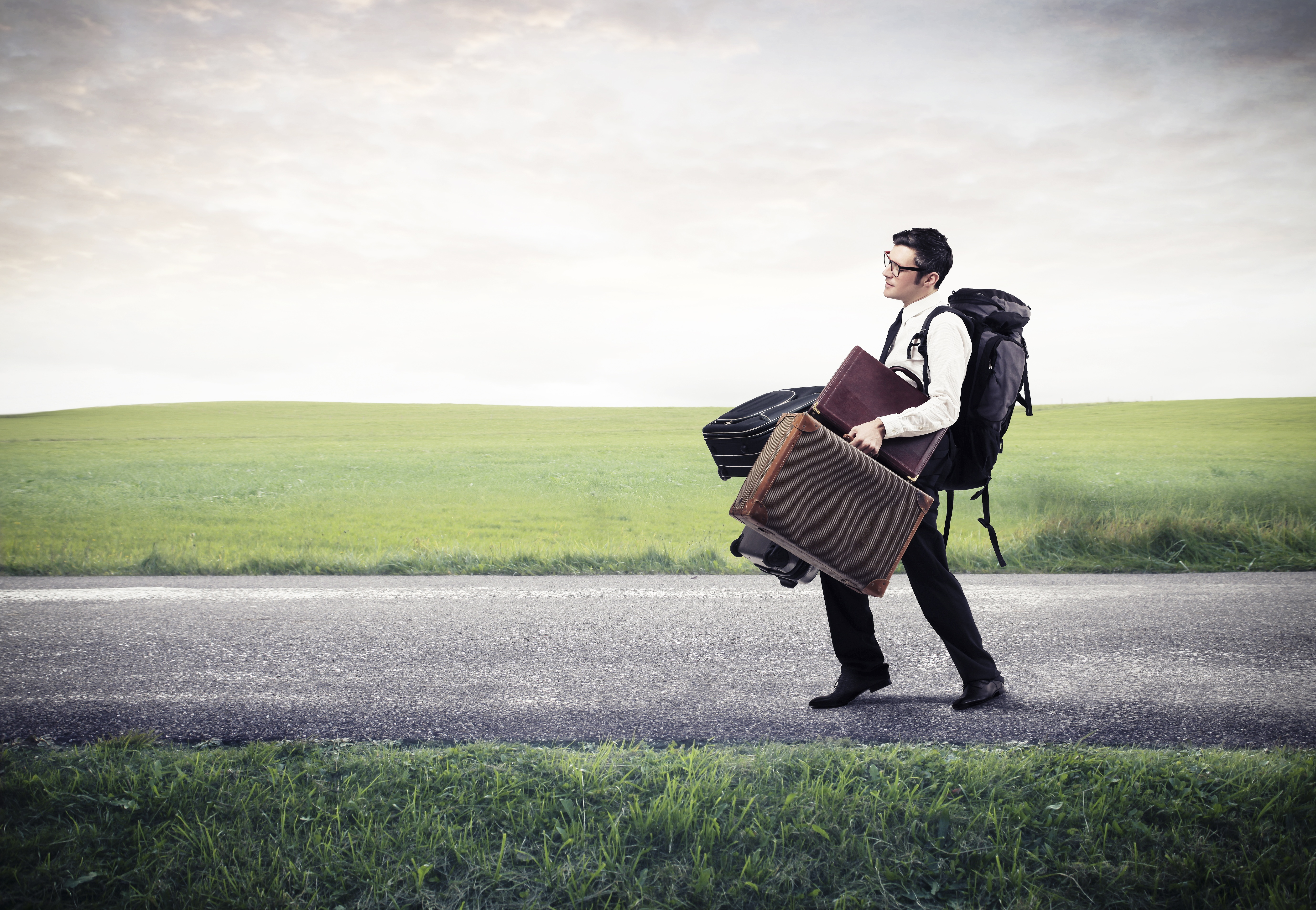 17933656 - Young Businessman With Many Luggages On The Road